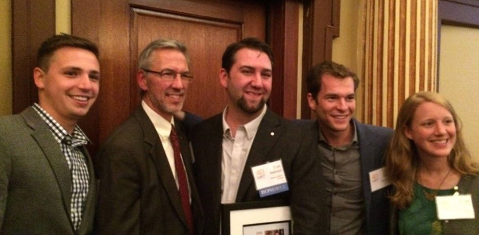 Evan Mathison Accepts 40 Under Forty Award with Team and